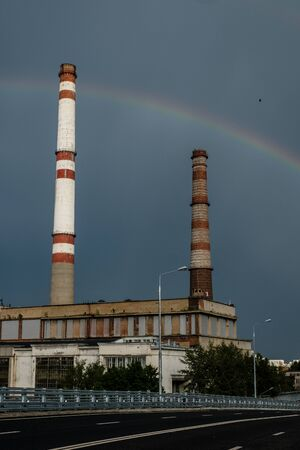 View of a thermal power station with a rainbow. Archivio Fotografico