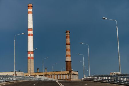 View of a thermal power station with a rainbow