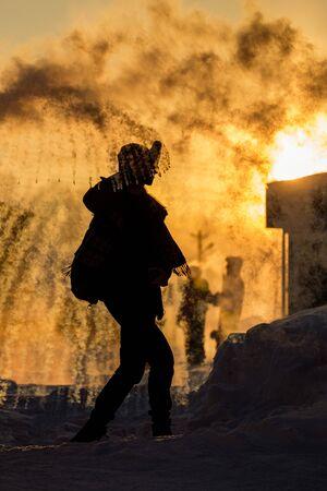 Frost effect hot water freezes man pours boiling water. Banco de Imagens