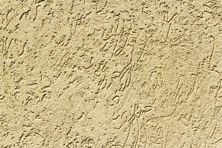 Sand-colored stucco. Finish exterior or interior walls. photo