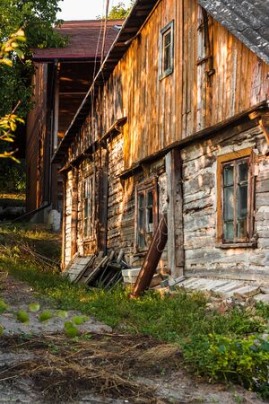 Facade of an old wooden house in a village. Foto de archivo