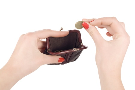 Female hands holding coin and purse isolated on white Stock Photo - 16650900