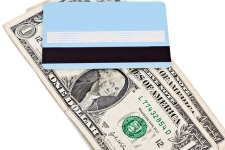 Bank credit card and dollars isolated on a white background photo