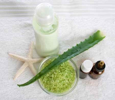Aloe, bath salt, starfish and shower gel on a towel
