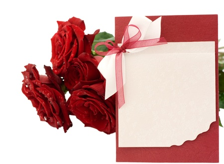 Blank greeting and a bouquet of red roses isolated Stock Photo
