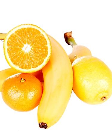 Lemon, banana, sliced orange and tangerine isolated on white background