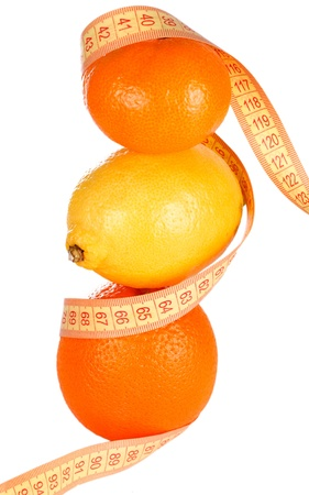 Weight loss and healthy dieting concept  Orange, lemon and mandarin with measure tape  Isolated over white