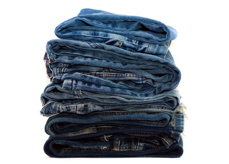 Pile of trousers made of blue denim jeans