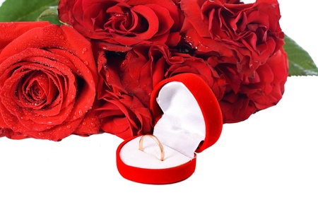 Ring in the package, and a red rose isolated on white background photo