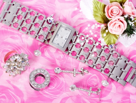Jewelry and watches on a pink background
