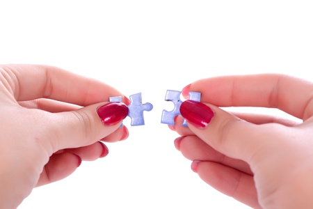 Hands holding two jigsaw puzlle for joining  Stock Photo