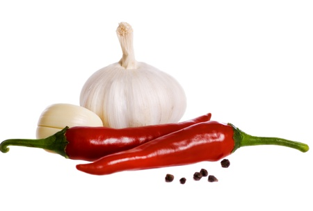 still life of garlic pepper and spice isolated on white background