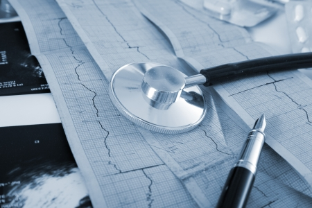 Cardiogram of the heart, stethoscope and pills