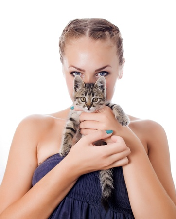 Portrait of a cute girl with a kitten against white background