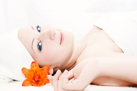 A woman relaxes after getting a massage at a day spa Stock Photo
