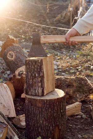 Man is chopping wood