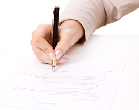 testimony: Close up of female hand signing a contract, mortgage