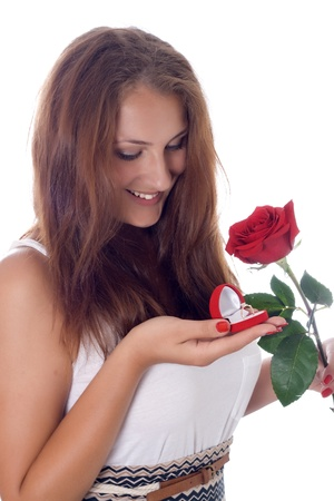 girl was presented with a red rose and a box with a ring Stock Photo - 17276120