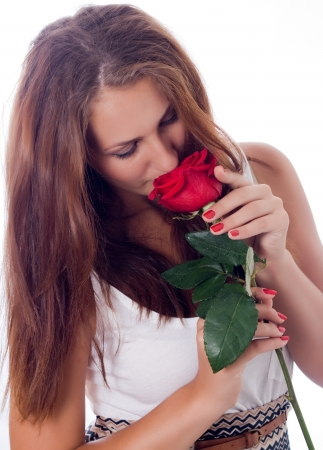 girl enjoys the scent of red roses Stock Photo - 17276131