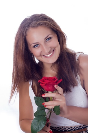 portrait of attractive caucasian smiling woman isolated on white studio shot with red rose looking at camera Stock Photo - 17276121
