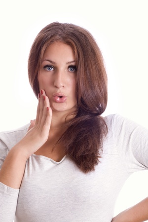 portrait of a surprised young woman, isolated against white background