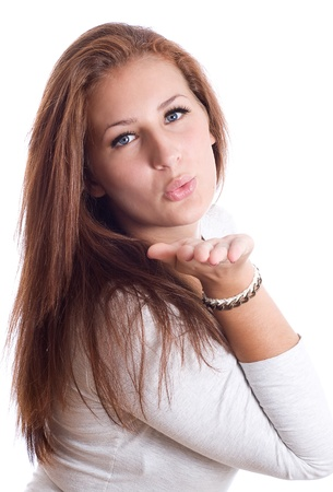 cute young female blowing a kiss ,white background Stock Photo - 17276058