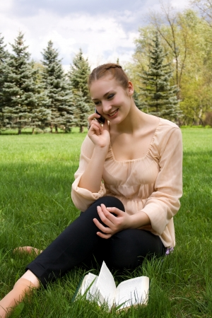 Woman relaxing in nature. Talking on the phone Stock Photo - 17275944