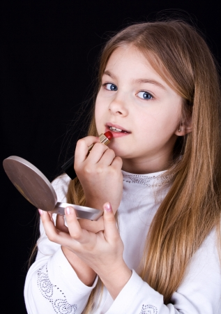 little girl with lipstick photo