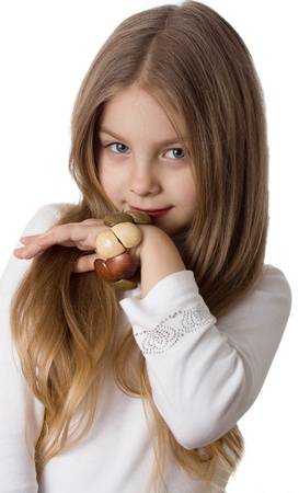 little girl with a wooden bracelet poses for the camera Stock Photo