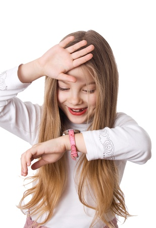 schoolgirl looks at his watch and worried that the late Stock Photo