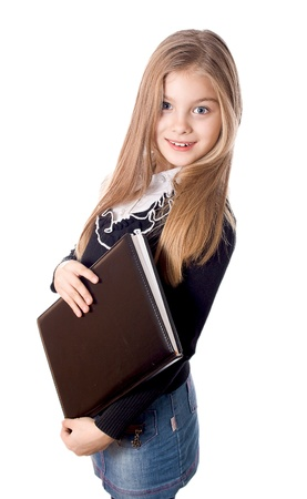 Smiling school girl standing with blank book in hands, isolated on white photo