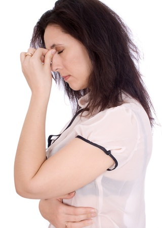 A woman having a headache, closeup isolated Stock Photo - 17333690