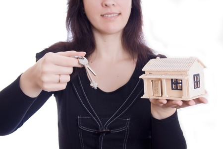 Picture of womans hands holding house and keys photo
