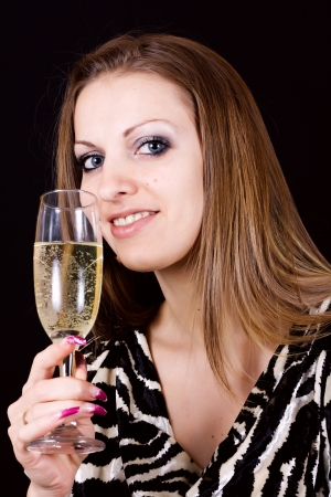 Beautiful woman enjoying a glass of pink champagne photo