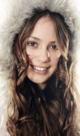 Beautiful smiling winter coat girl photo