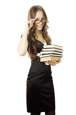 Student with textbooks in her arm isolated Stock Photo