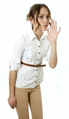 Profile view of a young woman gesturing a verbal call against white background Stock Photo - 17414934