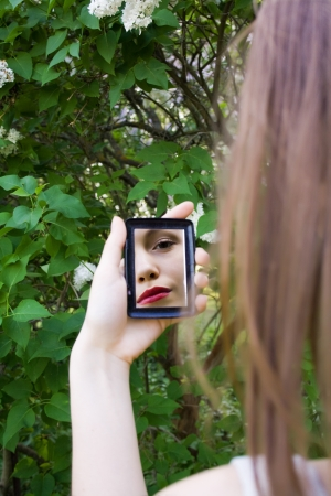 reflection of a girl in the mirror Stock Photo - 17414758