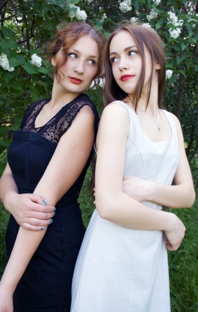 teen girls back to back Stock Photo - 17444482