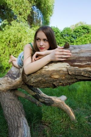 Beautiful girl lying on a tree Stock Photo - 17405632