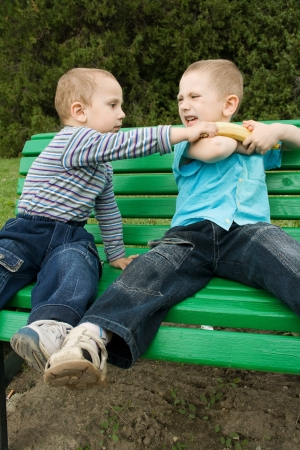 people fighting: boys are fighting because of the banana Stock Photo