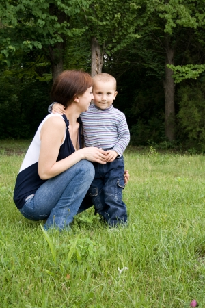 child with his mother played on green grass Stock Photo - 17416873