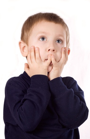 caucasian boy covering his mouth by hand, isolated over white background photo