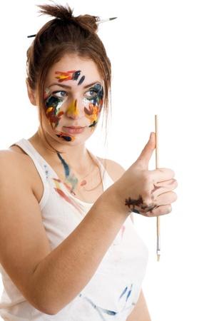 Beautiful girl with brushes  Isolated on white background Stock Photo - 17416876