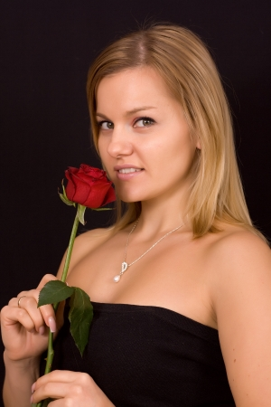 Beautiful woman smelling red bud of roses Stock Photo - 17419126