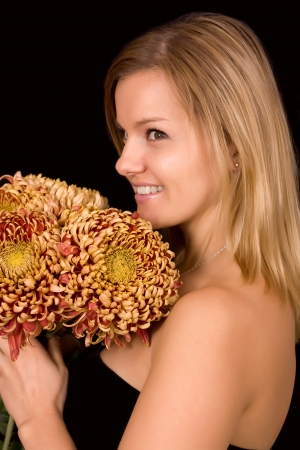 Romantic image of a young woman with yellow chrysanthemums Stock Photo - 17419125