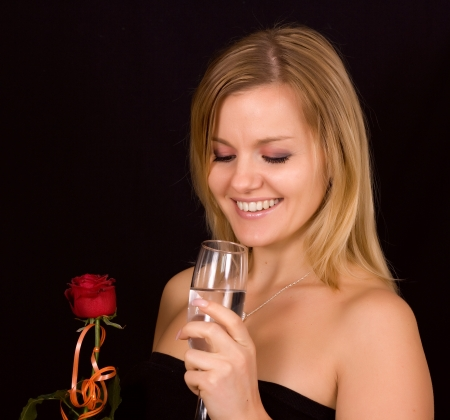 Beautiful woman smelling red bud of roses Stock Photo - 17418931