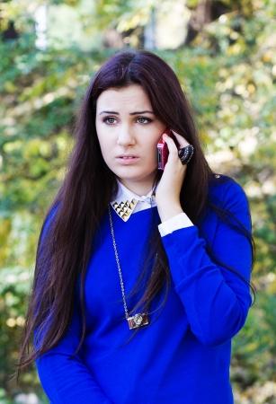 Beautiful teen girl talking on cell phone Stock Photo - 17450088