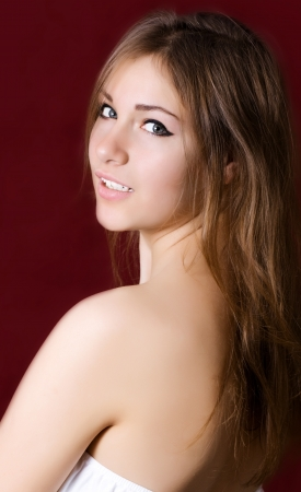 Young cute woman on a red background Stock Photo - 17423402