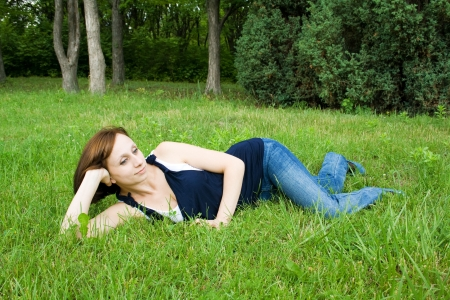 Beautiful girl lying on the grass enjoying the peace Stock Photo - 17449347
